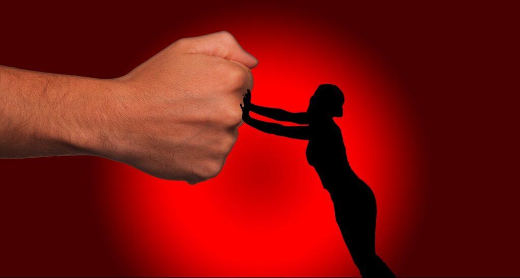 Basta violenza sulle donne ombra sfondo rosso